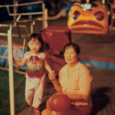 Photo by Mindy Tan (2004): Mother and daughter at Jurong East Central Fun-Fair
